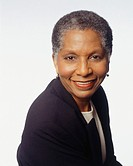 Senior woman smiling, posing in studio, (Portrait)