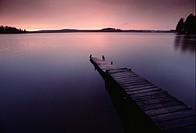 Pier in Lake Region at dusk, Finland, copy space