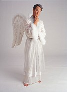 Male in angel outfit, pondering