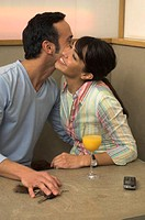 young couple embracing each other in restaurant
