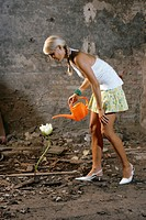 Woman watering one flower