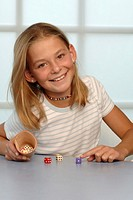 Girl playing with dice