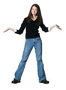 a teenage asian female in jeans and a black sweater gestures with her arms and smiles