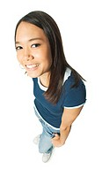 an ethnic female teen in jeans and a blue shirt smiles up at the camera