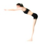 abstract full body shot of a young adult in a workout outfit as she leans over and stretches