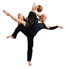 a young caucasian modern dance couple perform as the male balances on one leg as the female rests on his extended leg