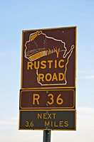 SIGNS  Near Kenosha, Wisconsin. Rustic road sign with route information, state designated scenic rural roads, brown with yellow lettering