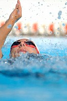 Female Swimmer Swimming Backstroke