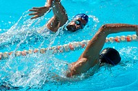 Male and Female Swimmer Racing