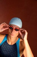 Female Swimmer Adjusting Goggles