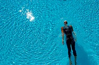 Bird's Eye View of Female Swimmer Gliding In Pool