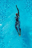 Bird's Eye View of Female Swimmer Swimming Backstroke