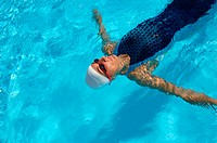 View of Female Swimmer Swimming Backstroke