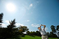 Man making a golf stroke with full strength