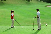 Female golfer lining up her tee shot