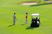 Female golfer pointing out the line to take