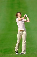 Woman watching her golf shot