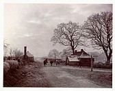 A photograph of a village street in winter, taken by Colonel Joseph Gale (c 1835-1906) in about 1890. Overcast sky, bare trees and heavy frost give a ...