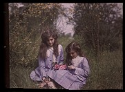 An autochrome of her daughters sitting in a garden tying roses together, taken by Etheldreda Janet Laing. In the summer of 1908 Laing took a series of...