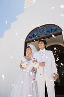 Confetti showering upon newlyweds (thumbnail)
