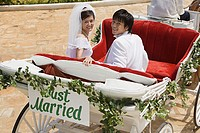 Bride and groom in horsedrawn carriage
