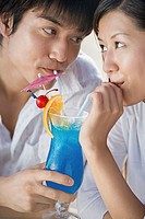 Couple drinking cocktail