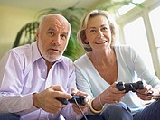 Mature couple playing computer game (thumbnail)