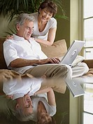 Mature couple using laptop computer