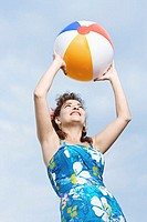 Woman holding a beachball