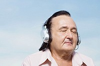 Senior man listening to music