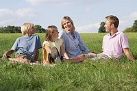 Family relaxing in a field