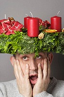 Man with advent wreath on his head