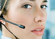 Woman wearing headset, close-up