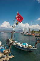 Fishing boats and Turkish flag at Fethiye, Turkey