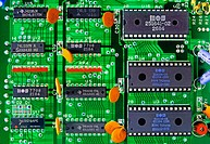 Computer board, printed circuit board which connects to a slot a computer