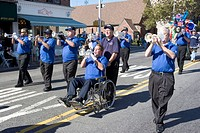 Disabled trumpeter in a marching band at the Ragamuffin Parade in the Bay Ridge section of Brooklyn, New York