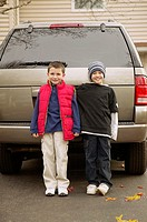 Two brothers standing in their driveway