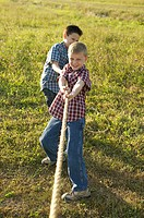 Two boys pulling on a rope (thumbnail)