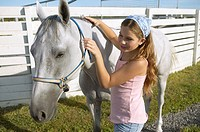 Girl petting a horse (thumbnail)