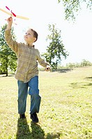 Boy playing with a toy airplane (thumbnail)