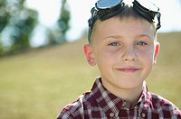Boy with aviator goggles on his head (thumbnail)