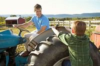 Father on a tractor talking to his son (thumbnail)