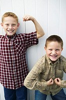 Two boys flexing their muscles (thumbnail)