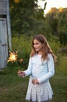 Girk holding a sparkler