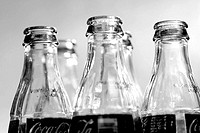 Black and white close up of glass pop bottles