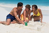 Family building sand castle.