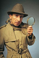 Man in trenchcoat with magnifying glass, Character portrait.