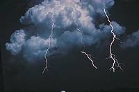 CLOUDS WITH LIGHTENING STRIKING DOWN