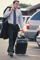 Man walking with luggage.