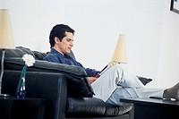 Man reading magazine.